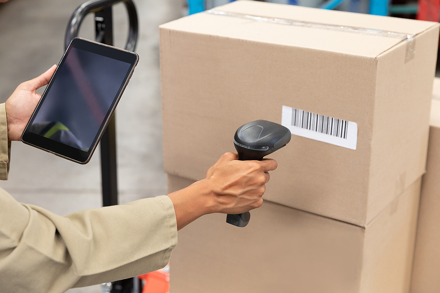 Female worker of a 3PL business scanning packages